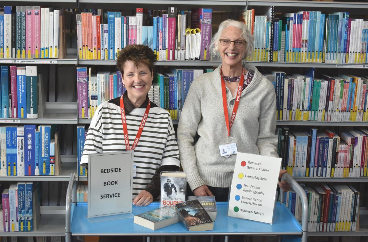 Volunteers Sue Ellingham and Louise Lindsay with one of the two book trolleys which will tour some of KGH's wards Book Service launch April 1