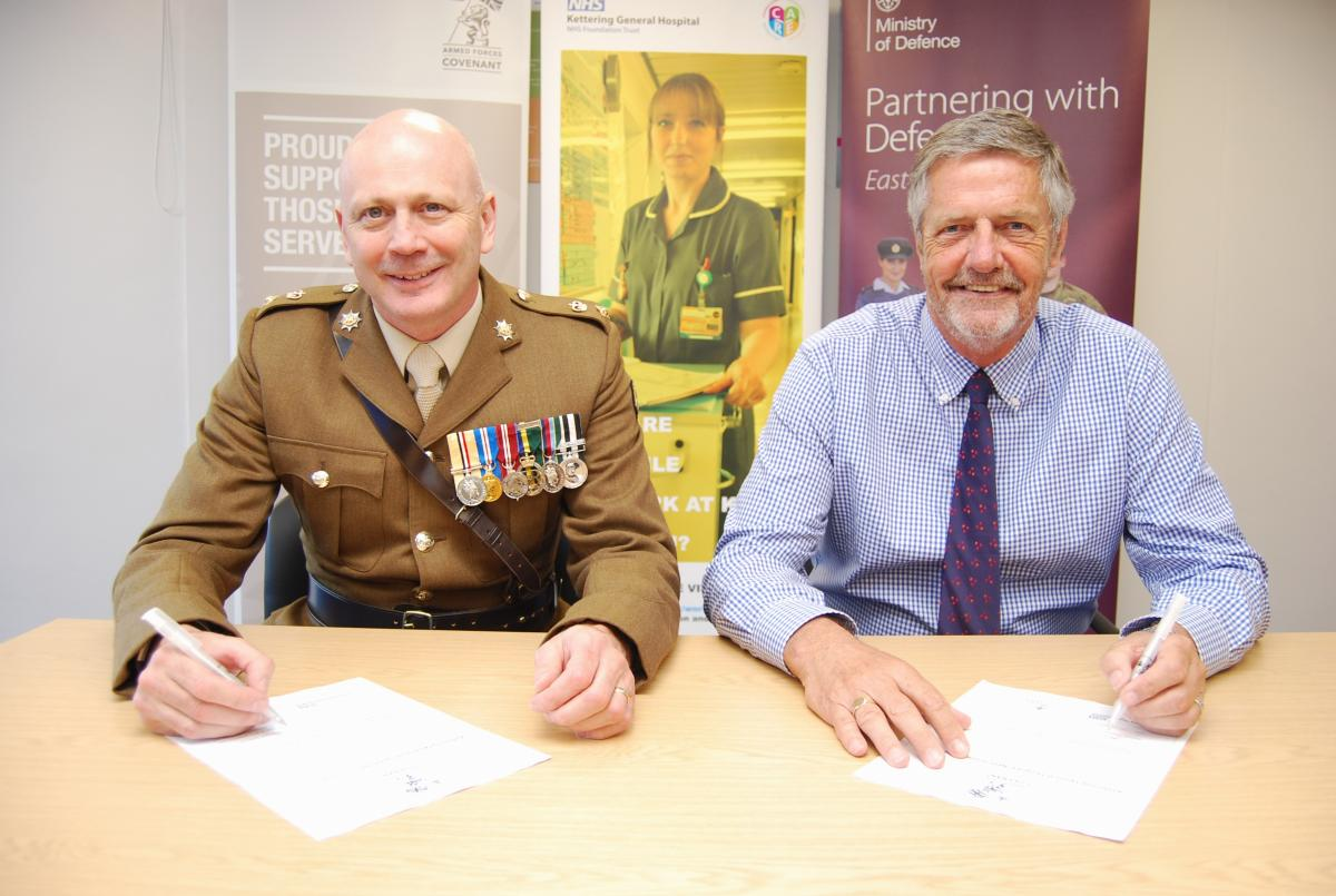 Photograph of Lt Col Keith Spiers and KGH Chairman Alan Burns signing the Armed Forces Covenant
